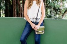 With fringe top, wide brim hat, small bag and jeans