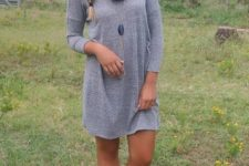 With gray ankle boots and necklace