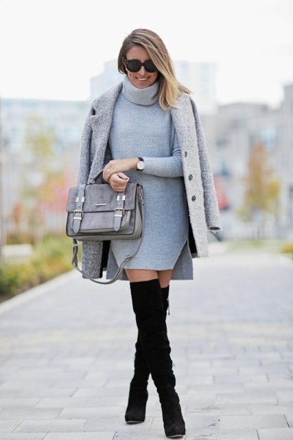 With gray coat, gray suede bag and black high boots