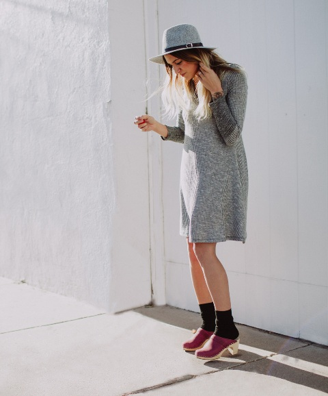 With gray knee-length dress, black socks and wide brim hat
