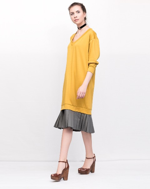 With gray pleated skirt and platform shoes
