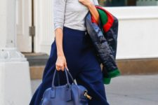 With gray shirt, navy blue wide leg pants and blue bag