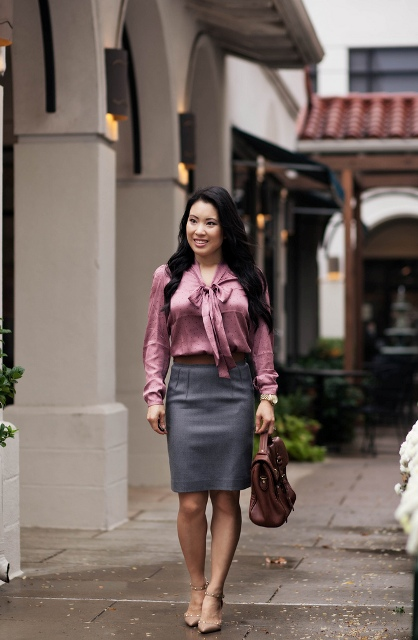 With gray skirt, brown belt, brown bag and shoes