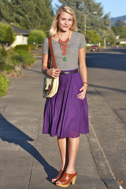 With gray t-shirt, necklace, purple skirt and two colored bag