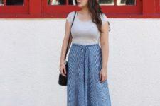 With gray t-shirt, printed maxi skirt and black bag