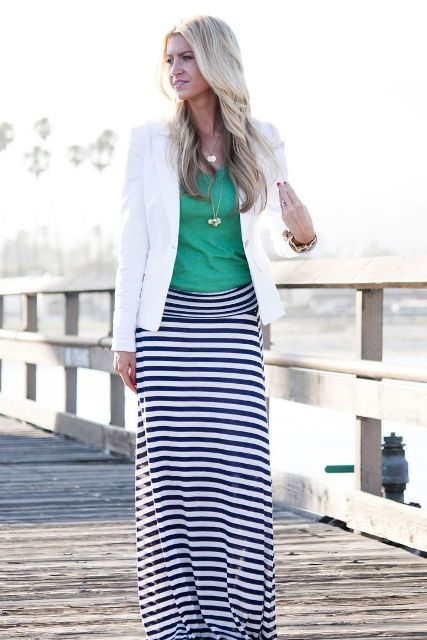 With green shirt, white blazer and flat shoes