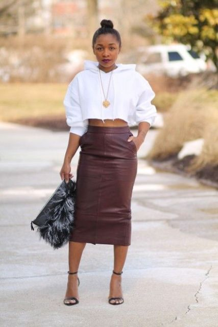 With high-waisted leather midi skirt, fur clutch and black sandals