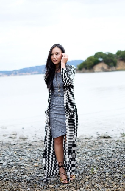 With knee-length dress and lace up sandals