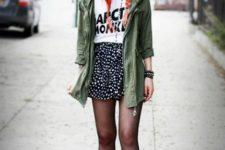 With labeled t-shirt, polka dot skirt, black hat and platform shoes