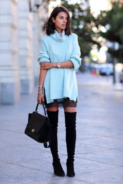 With lace skirt, high heeled boots and black bag
