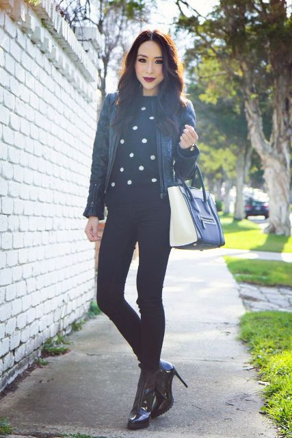 With leather jacket, skinny pants, ankle boots and two colored bag