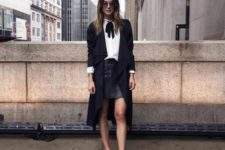 With leather skirt, long cardigan and flat shoes
