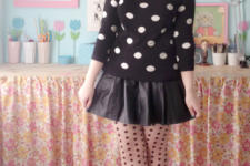 With leather skirt, printed tights and black pumps