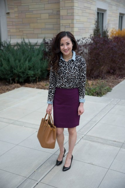 With light blue shirt, purple skirt, brown tote and black shoes