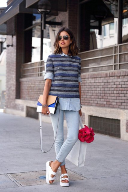 With light blue shirt, skinny pants, clutch and white platform sandals