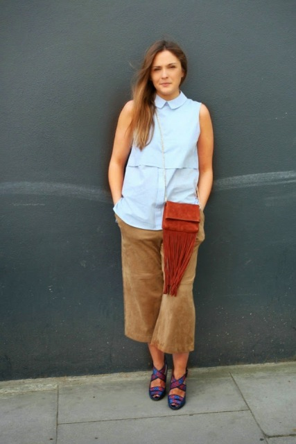With light blue sleeveless top, fringe bag and colorful shoes