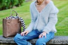 With loose jeans and beige tote