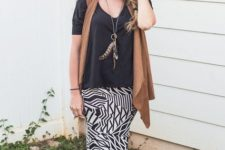 With loose shirt, printed maxi skirt and black hat