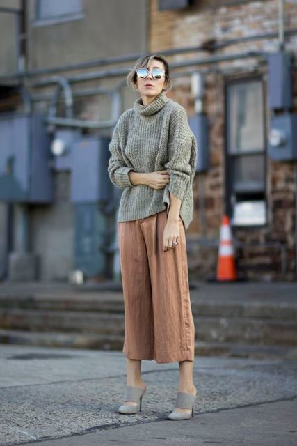 With loose sweater and culottes