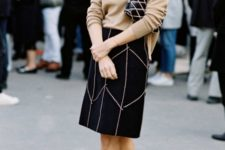 With loose sweater, printed skirt and printed clutch