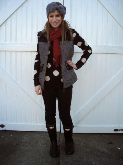 With marsala scarf, vest, black pants and high boots