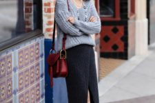 With maxi skirt, brown ankle boots and leather bag