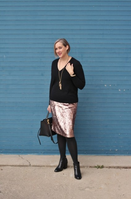 With metallic skirt, black tights, black ankle boots and black bag