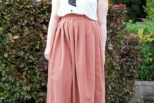 With midi skirt and black ankle boots