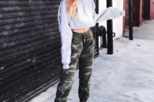 With military pants and sneakers