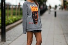 With mini skirt and silver platform shoes