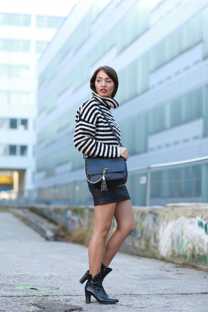 With mini skirt, black leather bag and ankle boots