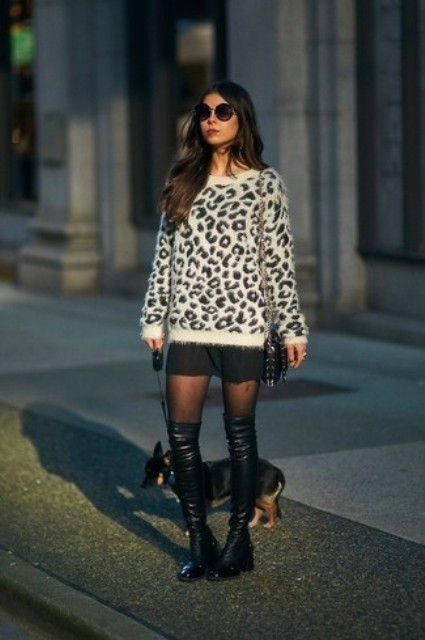 With mini skirt, leather over the knee boots and bag