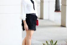 With mini skirt, red clutch and black pumps