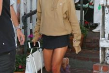 With mini skirt, white bag and fur flat sandals