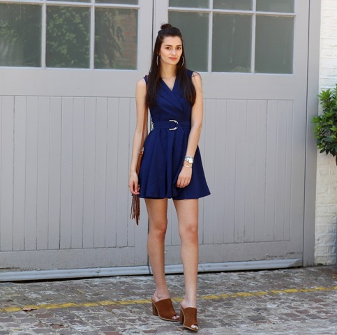 With navy blue dress and fringe bag