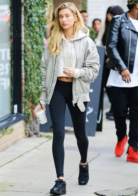 With navy blue leggings, gray jacket and black sneakers