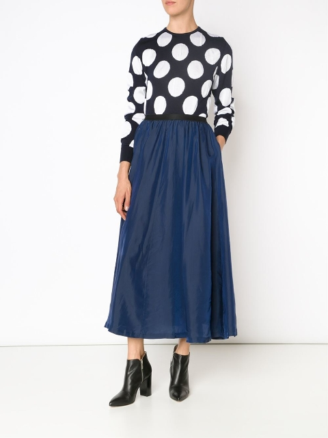 With navy blue maxi skirt and black leather ankle boots