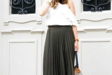 With off the shoulder blouse and pleated skirt