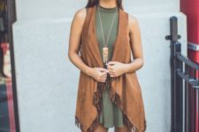 With olive green dress and boots