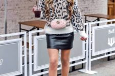 With pale pink bag, leather skirt and white ankle boots