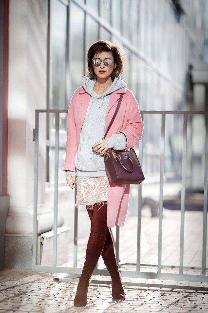 With pale pink coat, printed skirt, marsala bag and high boots