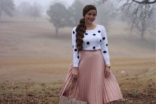 With pale pink pleated midi skirt, beige leather bag and pumps