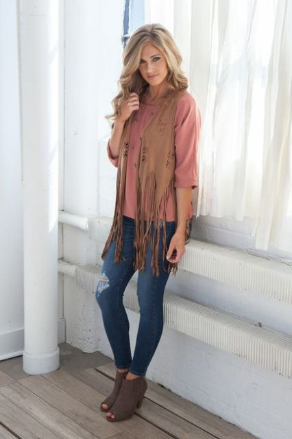 With pale pink shirt, distressed jeans and cutout boots
