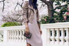 With pastel colored dress, leather jacket and mini clutch
