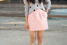 With pink mini skirt and black ankle strap shoes