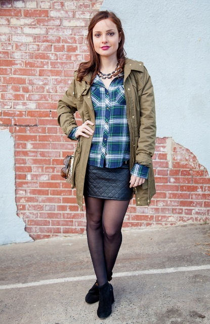 With plaid button down shirt, ankle boots and black mini skirt