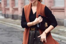 With pleated skirt, brown long vest and black bag