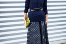 With polka dot maxi skirt, belt, printed clutch and black shoes