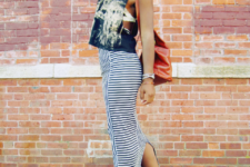 With printed crop top, hat, backpack and ankle boots