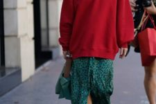 With printed maxi skirt, white boots and green bag